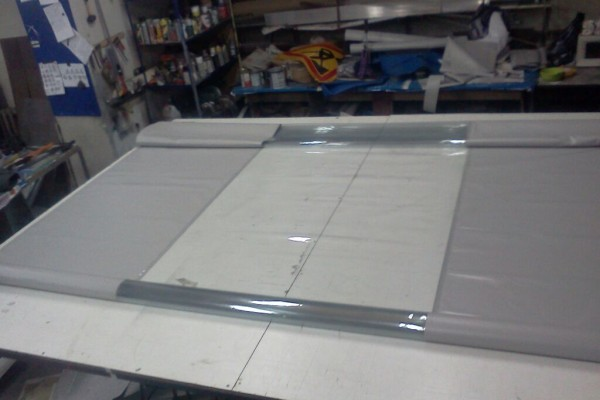 Изготовление ПВХ-шторы для автомойки с прозрачной вставкой в Новосибирске